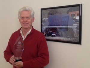 Secure Futures CEO Anthony Smith Holds the 2014 Solar Innovation Award